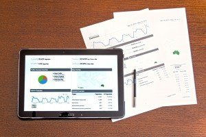 iPad and printed reports showing analytics